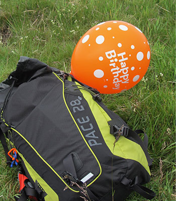 photo of birthday balloon tied to rucksack